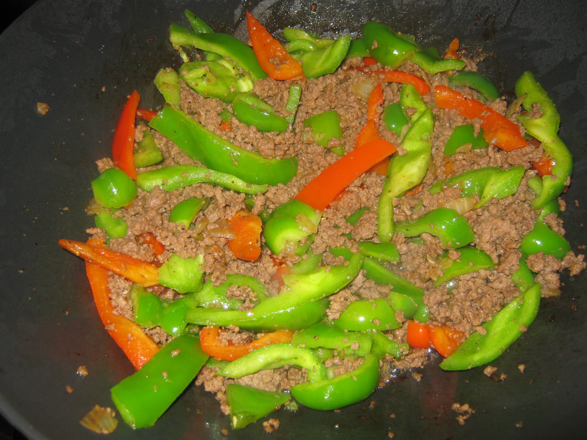 Mixed bell peppers and cooked ground beef