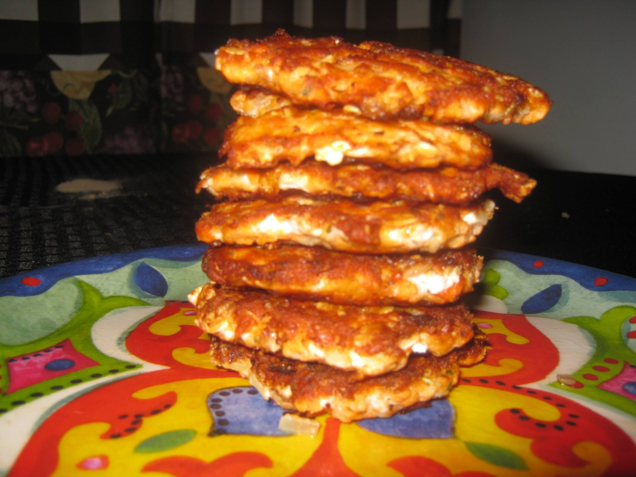 Salmon patties stacked on a plate