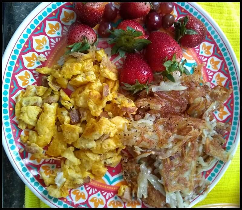 Hash browns strawberries eggs and ham