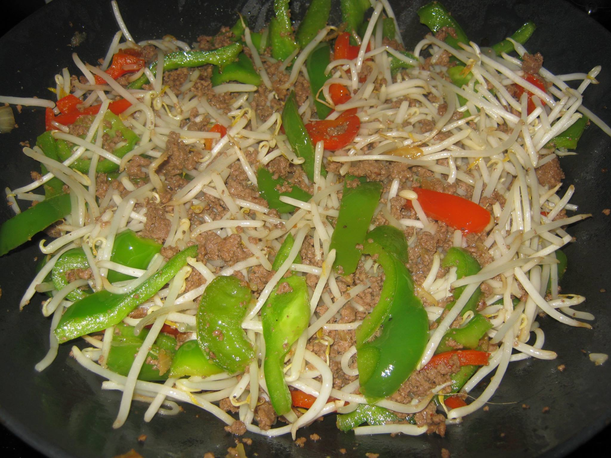 Mixed bell peppers and cooked ground beef and mung beans
