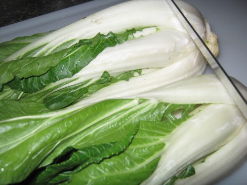 Snipping ends of bok choy