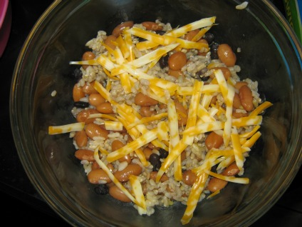 Bowl of black beans pinto beans rice and cheese