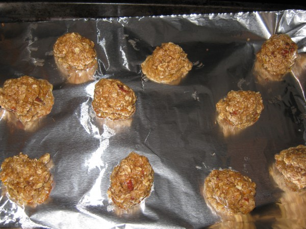 Uncooked oatmeal cookie batter on baking sheet