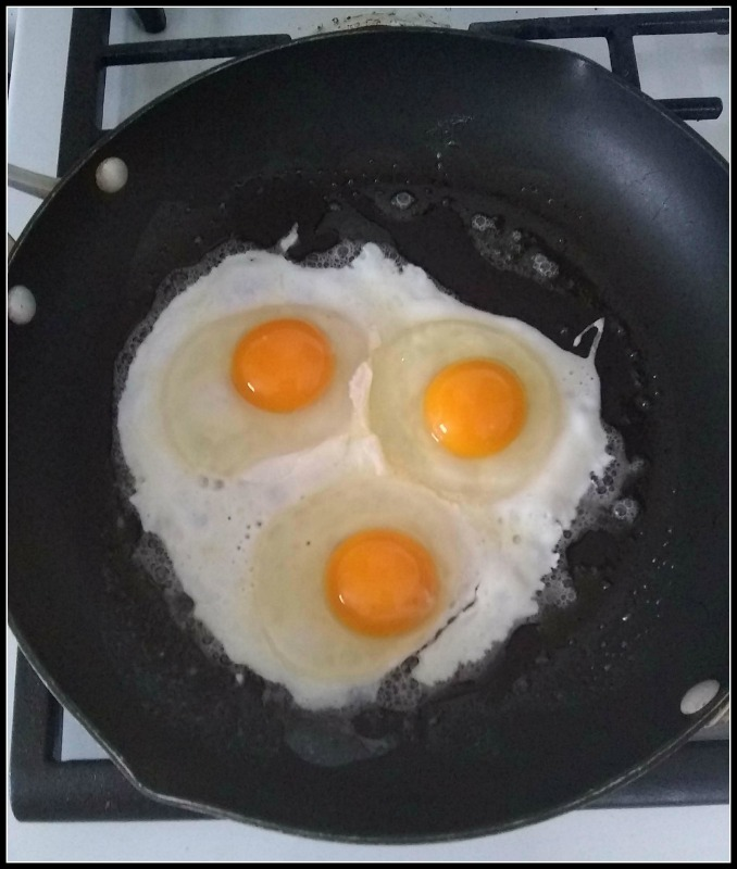 sunny side eggs in a pan