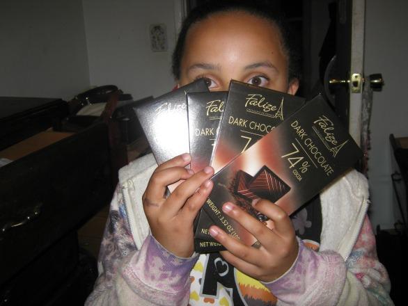 Child holding chocolates