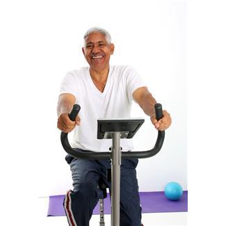 senior citizen riding a stationary bike