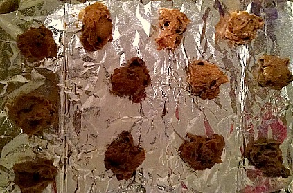 Raw chocolate chip cookie dough on baking sheet