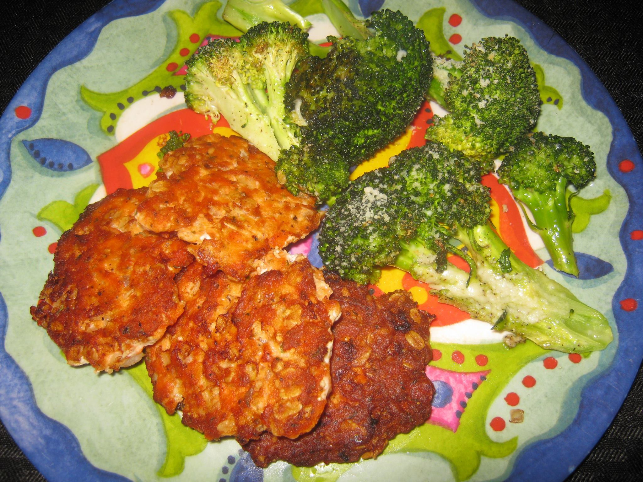 Salmon patties and broccoli parmesan cheese
