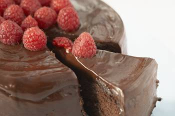 Chocolate caked topped with strawberries