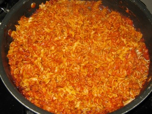 Cooked brown rice pasta in a pan