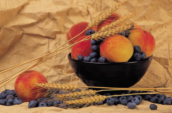 Bowl of nectarines blueberries and wheat