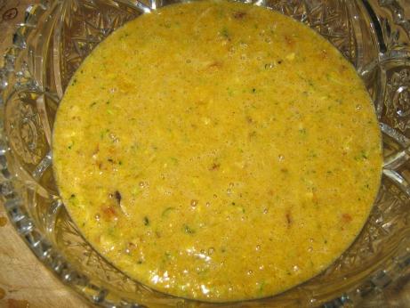 Zucchini bread batter in a glass bowl